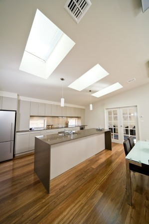 Velux skylights installed over a Kitchen area