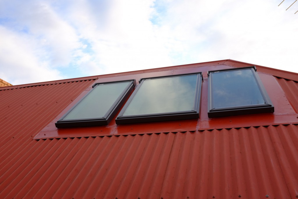 Roof windows with custom heritage red flashings